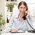 młodych · pracownik · biurowy · za · pomocą · laptopa · mówić · telefonu · posiedzenia - zdjęcia stock © milanmarkovic78