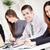 zespół · firmy · szczęśliwy · biznesmen · biuro · patrząc · kamery - zdjęcia stock © MilanMarkovic78