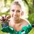 nő · ültet · virágok · portré · mosolyog · fiatal · nő - stock fotó © MilanMarkovic78