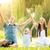 uśmiechnięty · szczęśliwą · rodzinę · szczęśliwy · rodziny · posiedzenia · trawy - zdjęcia stock © MilanMarkovic78