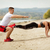 Couple Exercising On The Beach stock photo © MilanMarkovic78