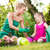 Mother and daughter planting flowers together stock photo © MilanMarkovic78