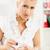 女性実業家 · 錠剤 · 小さな · オフィス · 顔 · 見える - ストックフォト © MilanMarkovic78