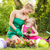 beautiful mother and daughter planting flowers stock photo © milanmarkovic78