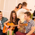 dziewczyna · gry · gitara · house · party · siedzieć - zdjęcia stock © MilanMarkovic78