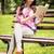 公園 · 女性 · 読む · ベンチ · 図書 · 笑みを浮かべて - ストックフォト © milanmarkovic78