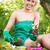 fiatal · nő · ültet · virágok · mosolyog · kert · nő - stock fotó © MilanMarkovic78