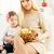 gelukkig · gezin · blond · meisje · eten · brood · voedsel - stockfoto © milanmarkovic78