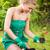 fiatal · nő · ültet · virágok · mosolyog · kert · fű - stock fotó © MilanMarkovic78
