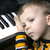 dreaming little boy sitting at the piano stock photo © mizar_21984