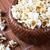 lot of salt popcorn into a bamboo bowl stock photo © mizar_21984