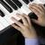 hands of a little boy on the piano keys stock photo © mizar_21984