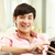 feliz · jovem · asiático · homem · telefone · móvel - foto stock © monkey_business