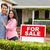 hispanic couple outside home with for sale sign stock photo © monkey_business