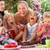 gyerekek · anyák · eszik · zselé · torta · szabadtér - stock fotó © monkey_business
