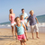 Portrait Of Running Family On Beach Holiday stock photo © monkey_business