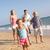 család · fut · tengerpart · mosolyog · férfi · nyár - stock fotó © monkey_business