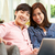 young chinese couple using laptop whilst relaxing on sofa at hom stock photo © monkey_business