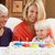 family celebrating childrens birthday with grandmother stock photo © monkey_business