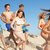 group of teenage friends enjoying beach holiday together stock photo © monkey_business
