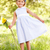 young girl walking through summer field holding sunflower stock photo © monkey_business