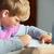 enfants · utilisant · un · ordinateur · portable · ordinateur · coup · séance · canapé - photo stock © monkey_business