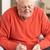 senior · man · ontspannen · stoel · home · kruiswoordraadsel - stockfoto © monkey_business