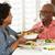 idős · pár · élvezi · étel · együtt · férfi · eszik - stock fotó © monkey_business