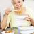 idős · nők · élvezi · étel · együtt · otthon - stock fotó © monkey_business