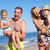grandparents and grandchildren enjoying beach holiday stock photo © monkey_business