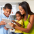 mother and children using digital tablet in kitchen together stock photo © monkey_business