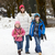 mother walking two children to school along snowy street in ski stock photo © monkey_business