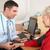 british doctor taking senior womans blood pressure stock photo © monkey_business