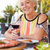 senior woman enjoying meal in outdoor restaurant stock photo © monkey_business