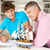 father and teenage son model making and painting stock photo © monkey_business