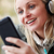woman wearing headphones and listening to music on smartphone we stock photo © monkey_business