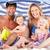 özenli · ebeveyn · çocuklar · oturma · kum · plaj - stok fotoğraf © monkey_business