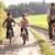 молодые · отец · детей · велосипедах · парка · девушки - Сток-фото © monkey_business