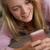 mosolyog · tinilány · mobiltelefon · otthon · számítógép · nő - stock fotó © monkey_business