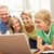 family using laptop at home stock photo © monkey_business