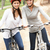 two female friends riding bikes in park stock photo © monkey_business