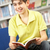 male teenage student in library reading book stock photo © monkey_business