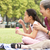 chinese grandmother with granddaughter in park blowing bubbles stock photo © monkey_business