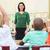 teacher talking to elementary pupils in classroom stock photo © monkey_business