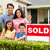 hispanic family outside home with sold sign stock photo © monkey_business