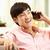 jovem · chinês · homem · telefone · móvel · sofá · casa - foto stock © monkey_business