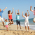 portrait of three generation family on beach holiday jumping in stock photo © monkey_business