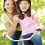girl on bike with mother stock photo © monkey_business