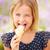 fiatal · lány · tart · fagylalt · aranyos · vanília · fagylalttölcsér - stock fotó © monkey_business