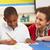 iskolás · fiú · tanul · osztályterem · tanár · boldog · gyermek - stock fotó © monkey_business